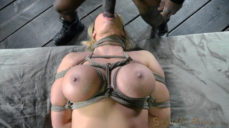 MILF with tit bondage gets her face fucked by black